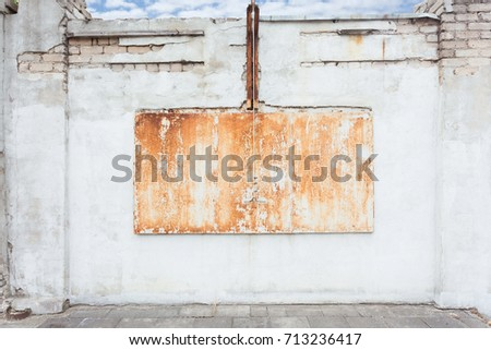 Urban grungy street wall with a metal rusty hatch, may be used as background or texture