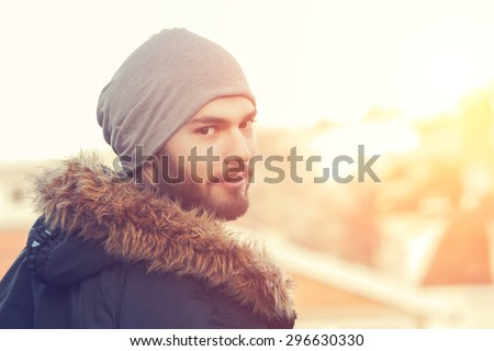 Urban guy posing in front of the camera. - stock photo
