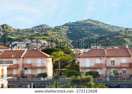 urban houses in comune Gaggi in Sicily, Italy in spring day - stock photo