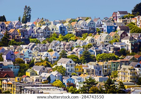 urban houses in San Francisco under blue sky - stock photo