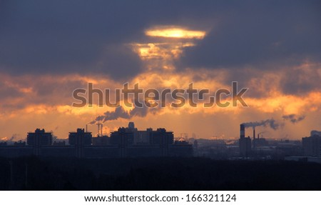Urban industrial building on background of dawn - stock photo
