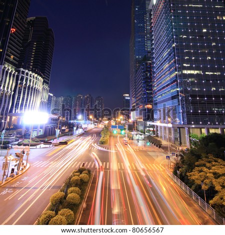 Urban landscape at night and through the city's traffic - stock photo