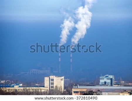Urban landscape of Almaty, Kazakhstan. Smog at the city. - stock photo