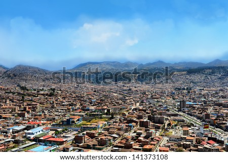 Urban landscape of Cusco, Peru. A view from a mountain. - stock photo