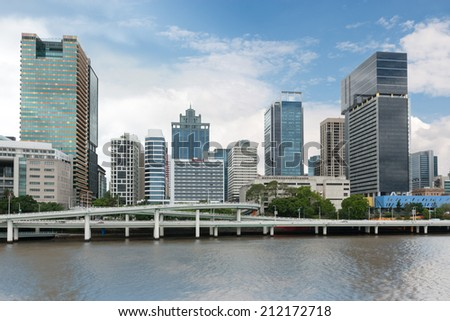Urban landscape of modern buildings and street by Brisbane River - stock photo
