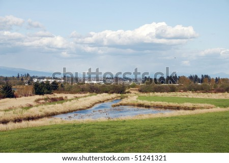 Urban landscape view with mountain and river. - stock photo