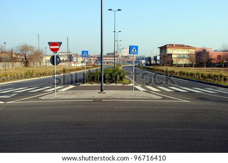 urban landscape with streets and road signs - stock photo