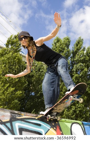 Urban life - Beautiful young women with skateboard - stock photo
