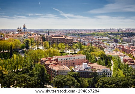 Urban life in the city of Madrid, Spain. Historic architecture in the Iberian Peninsula. Picture from above roofs of historic buildings. Center of the country, Spanish capital, tourist attraction. - stock photo