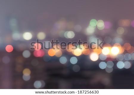 Urban night light bokeh , defocused background. Vintage style. - stock photo