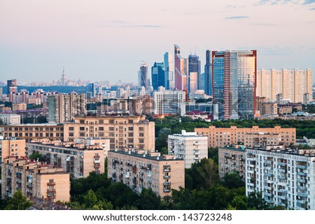 urban panorama with pink sunset in Moscow city