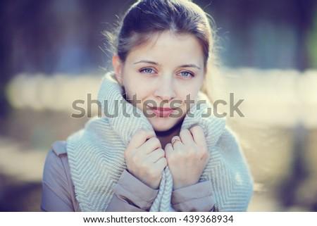 Urban portrait of a happy woman in coat - stock photo