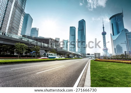 urban road and modern city skyline  - stock photo
