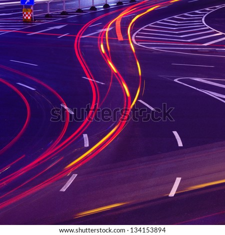 Urban road car light trails - stock photo