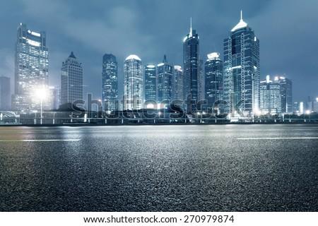 urban road,illuminated skyline background - stock photo