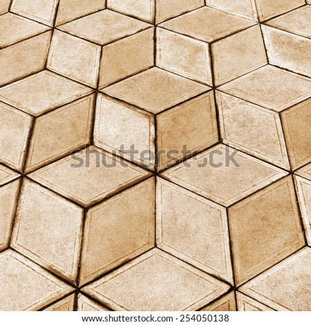 Urban road is paved with blocks of stone, cobblestone walkway, sepia - stock photo