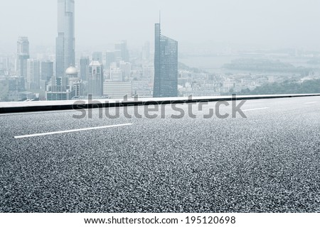 urban road with modern city - stock photo