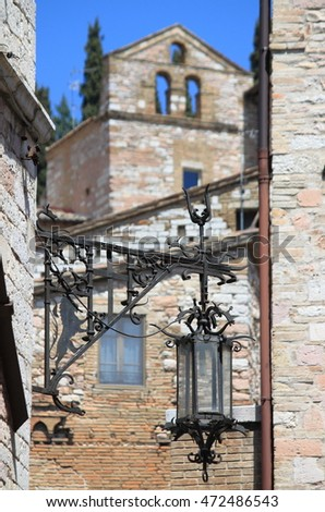 Urban scenic with medieval street lamp in Assisi, Italy