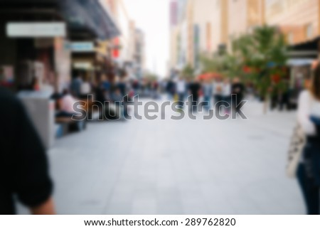 urban shopping mall, blurred with a blank area for copy - stock photo