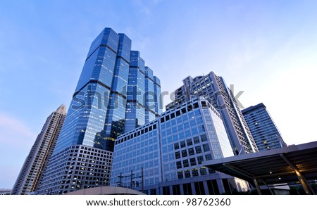 Urban - Skyscraper, tall building, business tower at downtown, City center, bussness area between evening to twilight night, Bangkok, capital city of Thailand - stock photo