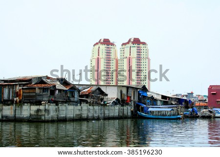 Urban slums, Jakarta, Indonesia. Urban slums in the historical port of Sunda Kelapa  of Jakarta, Central Java, Indonesia.  - stock photo