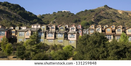 Urban Sprawl Makes it to the Country Homes Spring up For Domestic Living on Hillside - stock photo