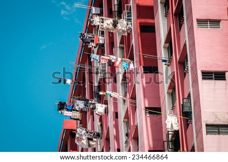 Urban sun drying clothes line in Singapore city - stock photo