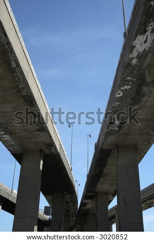 Urban trahsport: looking up to highway viaducts. - stock photo