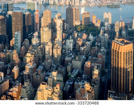 Urban view of midtown New York City including the East River - stock photo