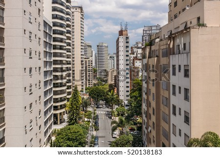 Urban view with the street and residential skyscrapers in downtown of San Paulo, Brazil.