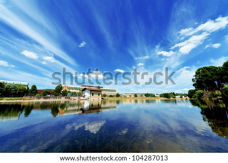 Urban water reservoir with reflection of the sky