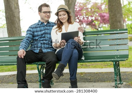 Urban woman sitting with tablet computer on stairs - stock photo
