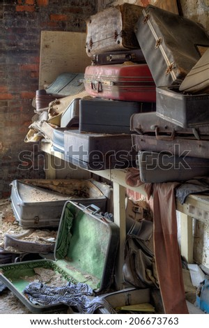 Urbex - empty, old and dirty suitcases, in light HDR processing