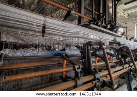 Urbex - Old american industry: old lace factory loom, in light HDR processing - stock photo