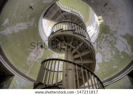 Urbex - Spiral stairway in an abandoned building, in light HDR processing.
