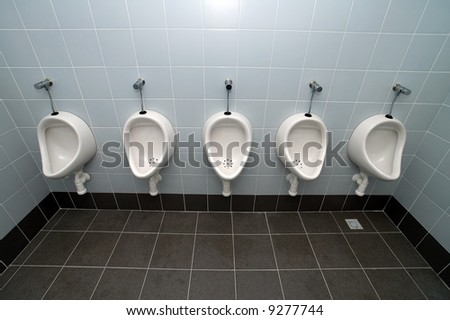 urinal man five clean toilets, no other objects - stock photo