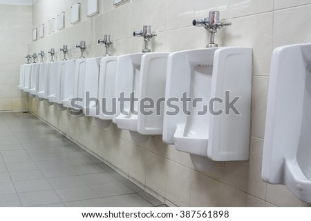 Urinals in public toilet - stock photo