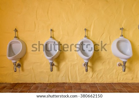 Urinals Men public in toilet room, wc - stock photo