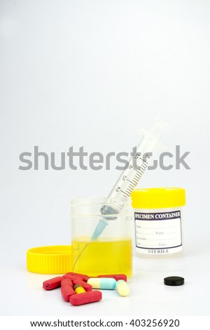 Urine sample bottle isolated on a white background with shallow depth of field (dof)