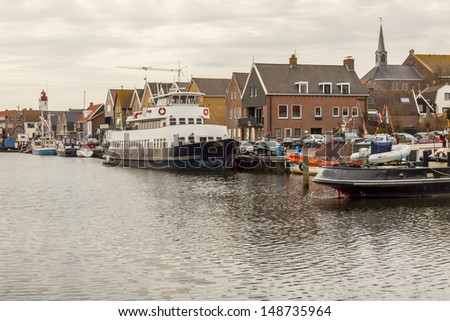 Urk town. View on small port in background lighthouse. Netherlands. - stock photo