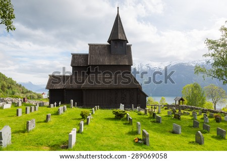 Urnes Stave church, oldest preserved of those typical norwegian wooden churches - stock photo