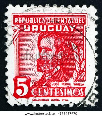 URUGUAY - CIRCA 1945: a stamp printed in the Uruguay shows Jose Pedro Varela, Politician and Author, circa 1945 - stock photo