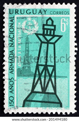URUGUAY - CIRCA 1968: a stamp printed in the Uruguay shows Lighthouse and Buoy, Sesquicentennial of National Navy, circa 1968 - stock photo