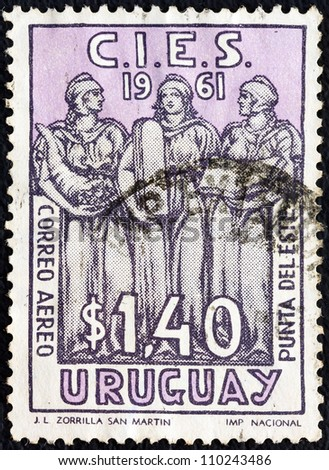 URUGUAY - CIRCA 1961: A stamp printed in Uruguay issued for the Latin-American Economic Commission Conference, Punta del Este shows Welfare, Justice and Education, circa 1961.