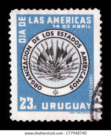 URUGUAY  - CIRCA 1958: A stamp printed in Uruguay  shows emblem of the Organization of American States, circa 1958 - stock photo
