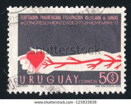 URUGUAY - CIRCA 1973: stamp printed by Uruguay, shows Arm with Arteries and Heart, circa 1973