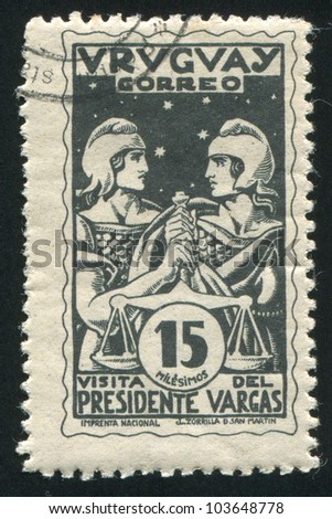 URUGUAY - CIRCA 1935: stamp printed by Uruguay, shows Uruguay and Brazil Holding Scales of Justice, circa 1935