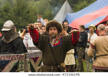 Urych, Ukraine - August 6,2016: Tustan Medieval Culture Festival in Urych, Western Ukraine, on August 6, 2016. Participant of the festival explained to the audience with gestures.