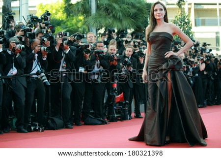 US actress Angelina Jolie poses on the red carpet before the screening of 'The Tree of Life' presented in competition at the 64th Cannes Film Festival on May 16, 2011 in Cannes.  - stock photo