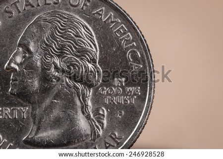 "US American coin with wording ""in God we trust"""